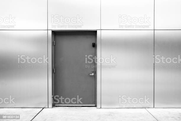 Close Grey Door With Aluminium Or Steel Wall Stock Photo - Download Image Now