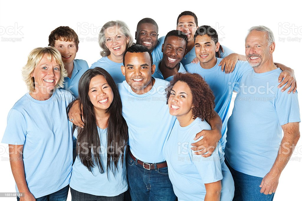 Close group of people together, all in blue shirts stock photo