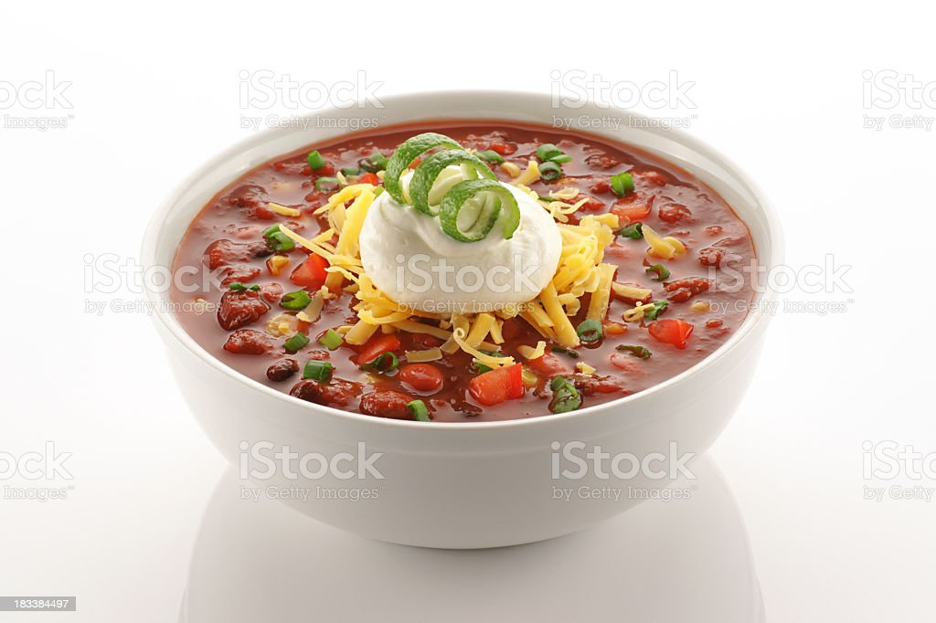 Close of up vegetarian chili in white bowl Bowl of vegetarian chili garnished with cheese, sour cream and a lime twist on clean white. Bean Stock Photo