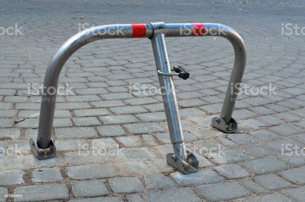 Close parking barrier on a cobblestone pavement stock photo