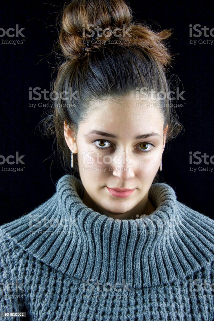 close portrait of beautiful woman with grey turtlenek wool sweater royalty-free stock photo