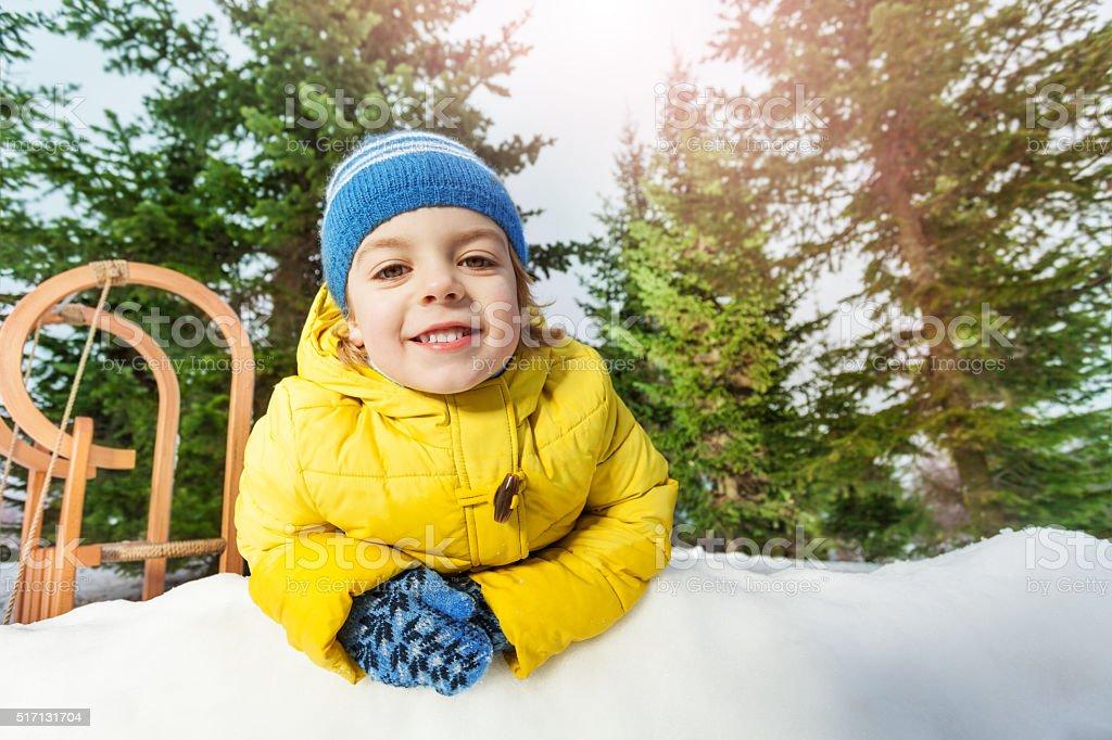 Close portrait of little boy in snow park stock photo