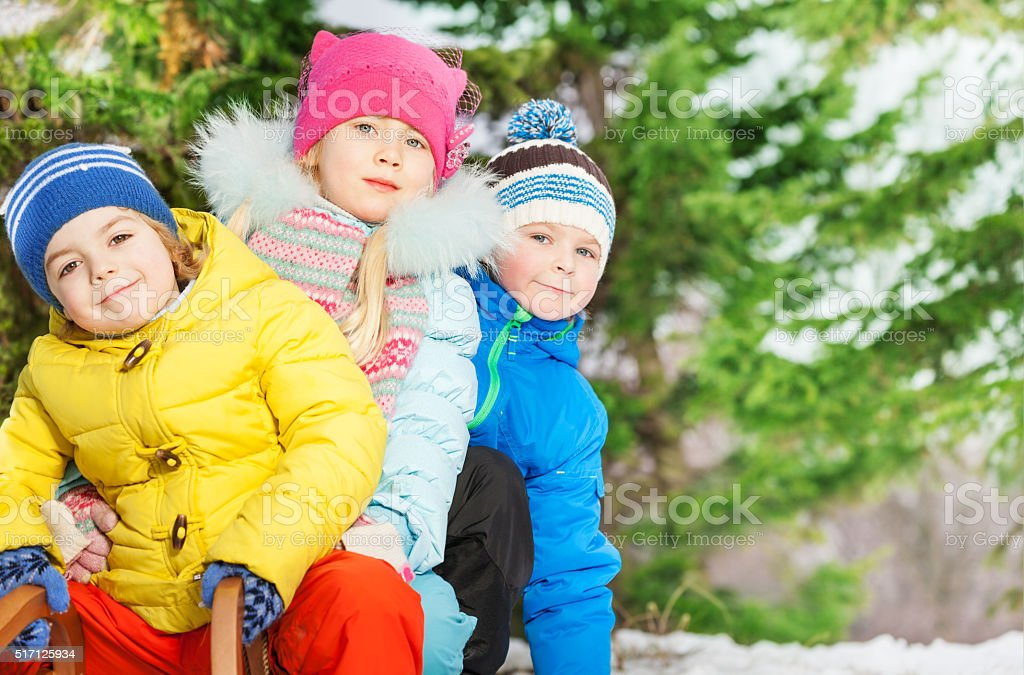 Close portrait of little kids in winter clothes stock photo