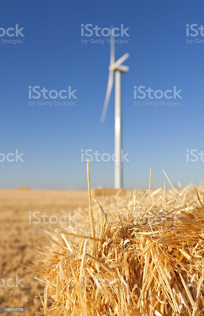 Close Shot Of A Straw Bale With An Eolic Generator Stock Photo