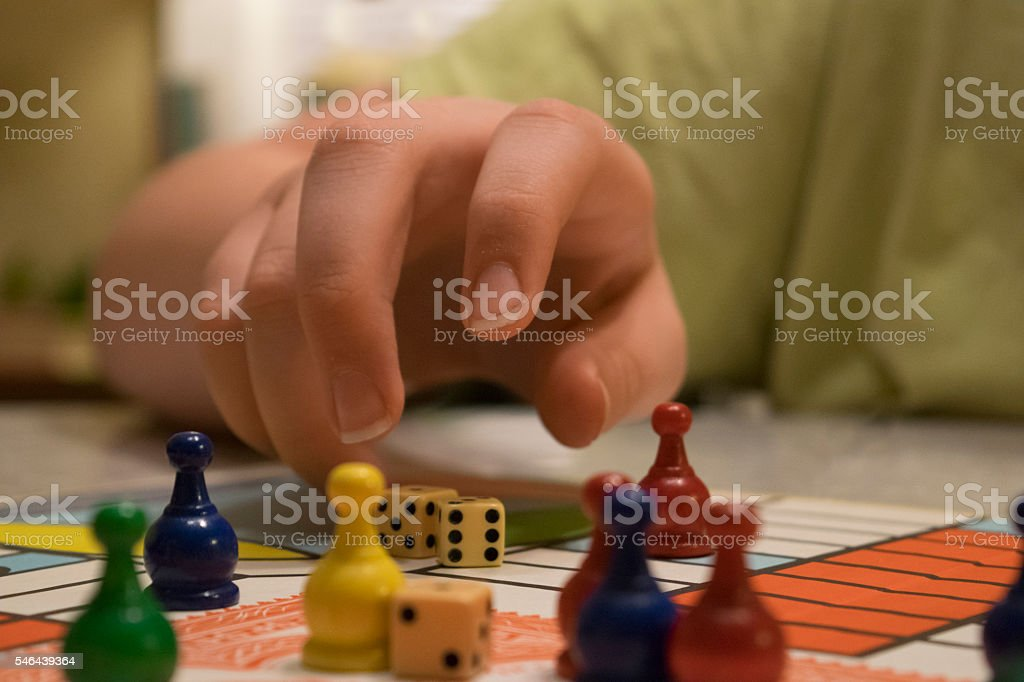 Close shot of dice and tokens on a game board stock photo