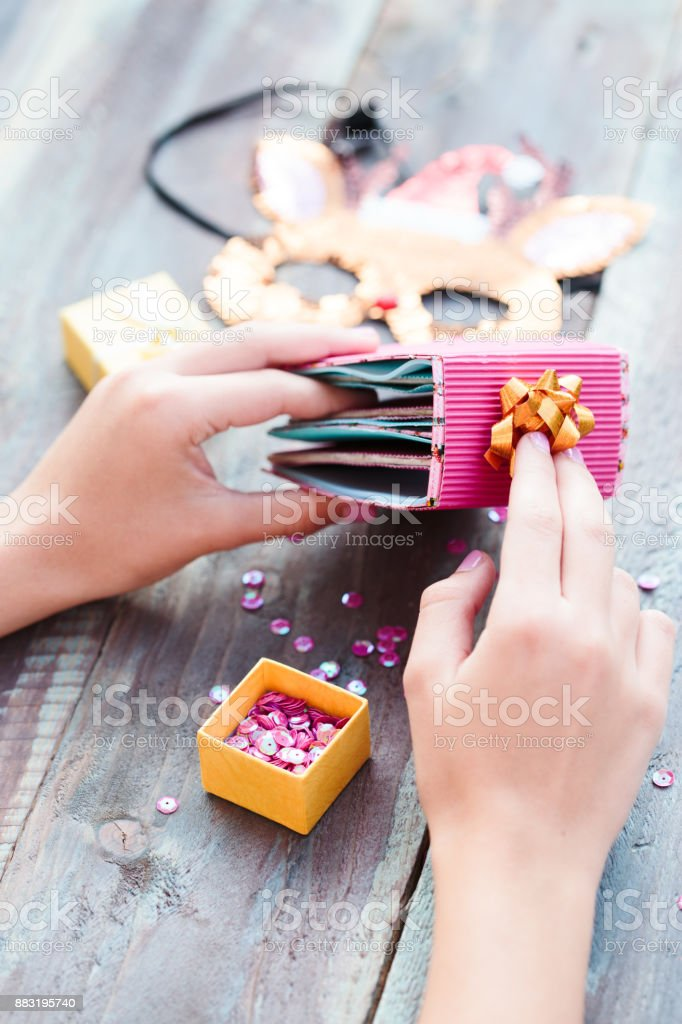 Close Shot Of Female Hands Making Decorations Of Christmas Gifts