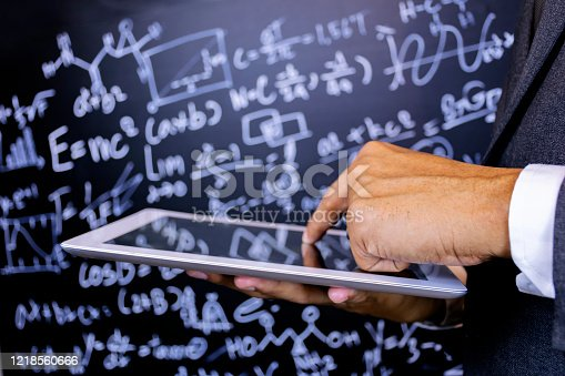491375966 istock photo Close to the hand of the teacher using a tablet 1218560666