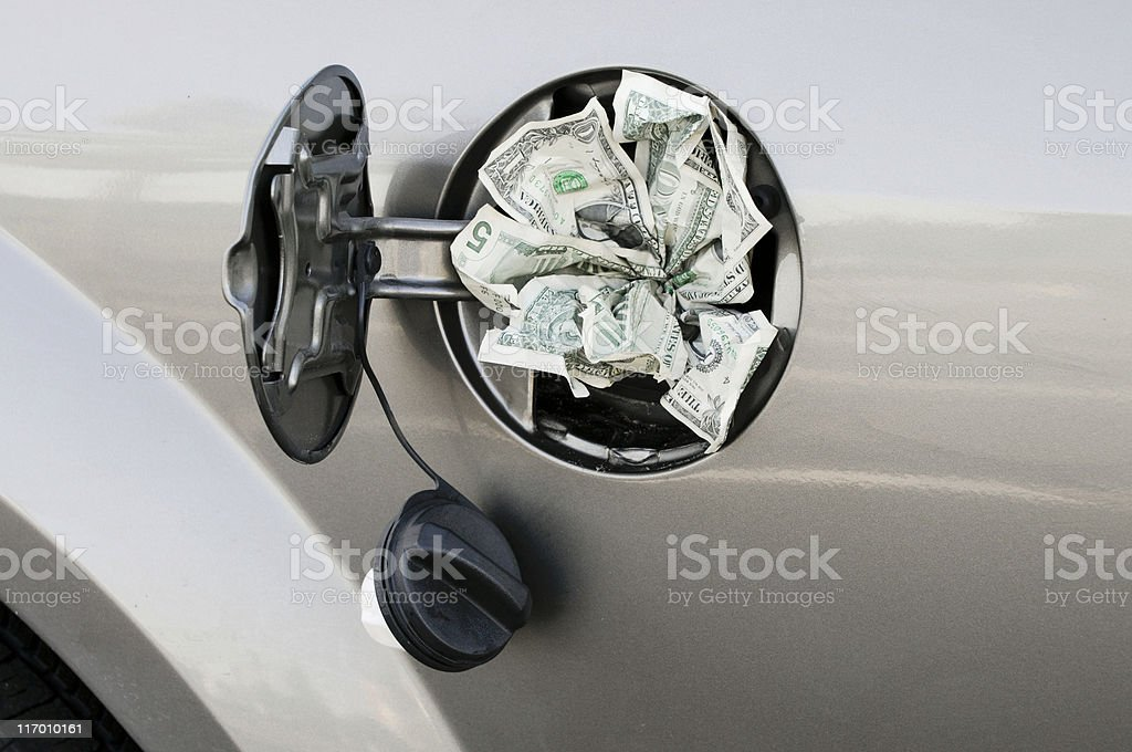 Close up a Gas Tank full of Money royalty-free stock photo