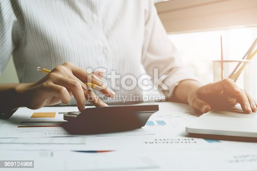 897852992istockphoto Close up a man working about financial with calculator at his office to calculate expenses, Accounting concept 959124968