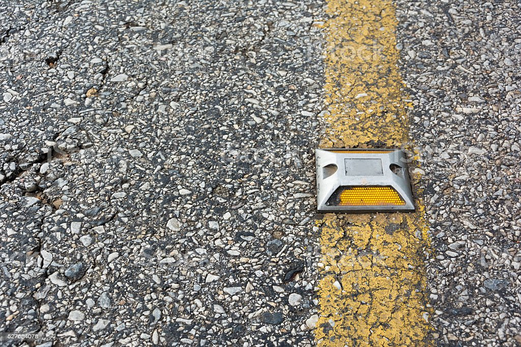 Close up a reflector on asphalt road. stock photo