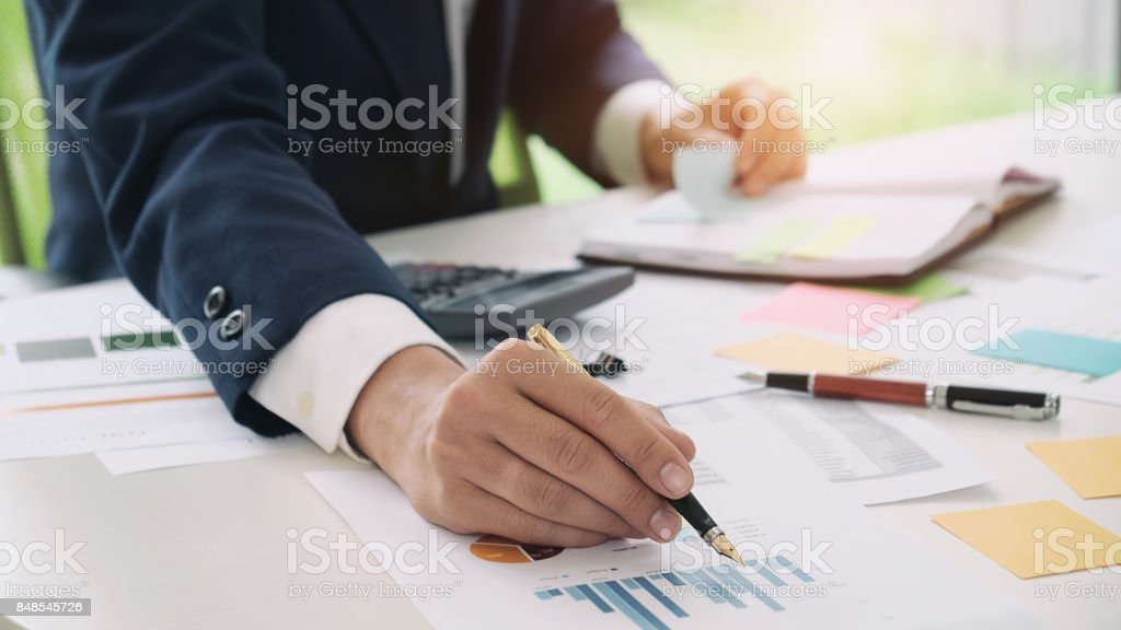 Close up accountant or banker making calculations. Savings, finances and economy concept. stock photo