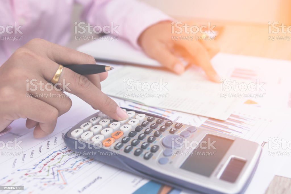 Close up accountant or banker making calculations. Savings,Concept finances and economy stock photo