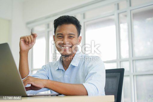 close up adult latin manager man sitting on desktop and looking with Confidence at office got business and lifestyle concept