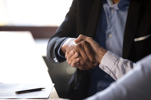 Close Up African Businessman Shaking Hands With Client Stock Photo - Download Image Now