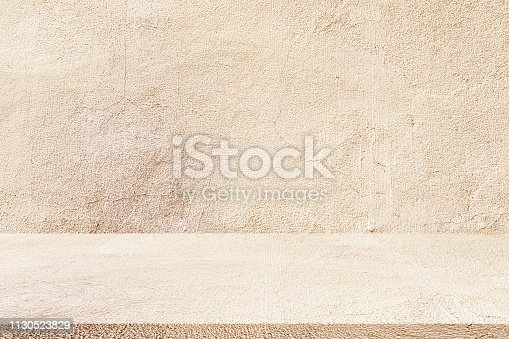 close up aged tan color  cement wall background texture with tile floor perspective plain for show or advertise or promote product and content on display