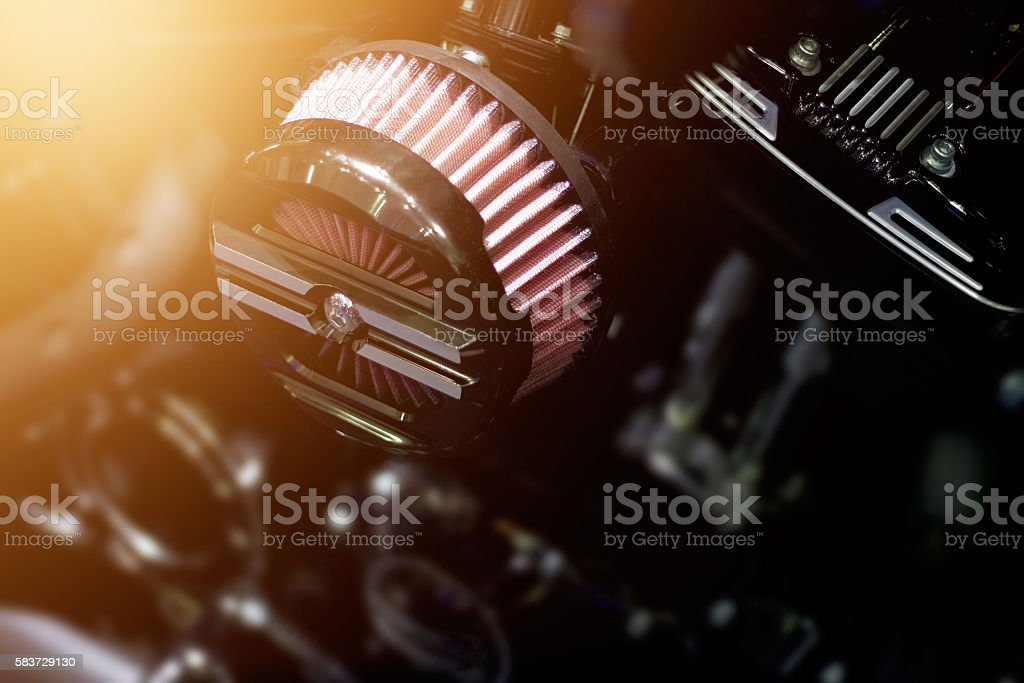 Close up air filter carburettor motorcycle on dark background stock photo
