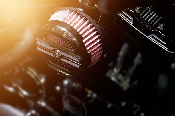 Close up air filter carburettor motorcycle on dark background Close up air filter carburettor motorcycle on dark background carburetor stock pictures, royalty-free photos & images