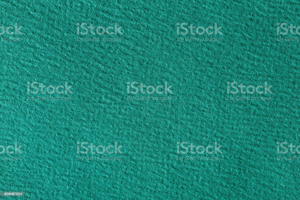 Close up aka macro shot of dark green construction paper stock photo