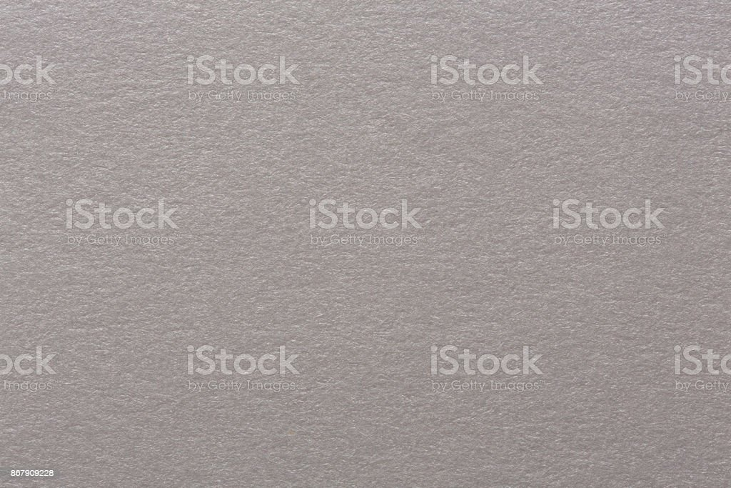 Close up aka macro shot of grey construction paper, showing text stock photo