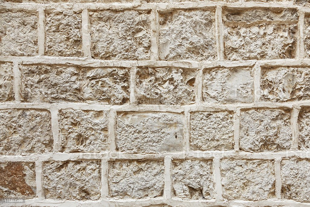 close up artificial brown rugged rock wall background Croatia royalty-free stock photo