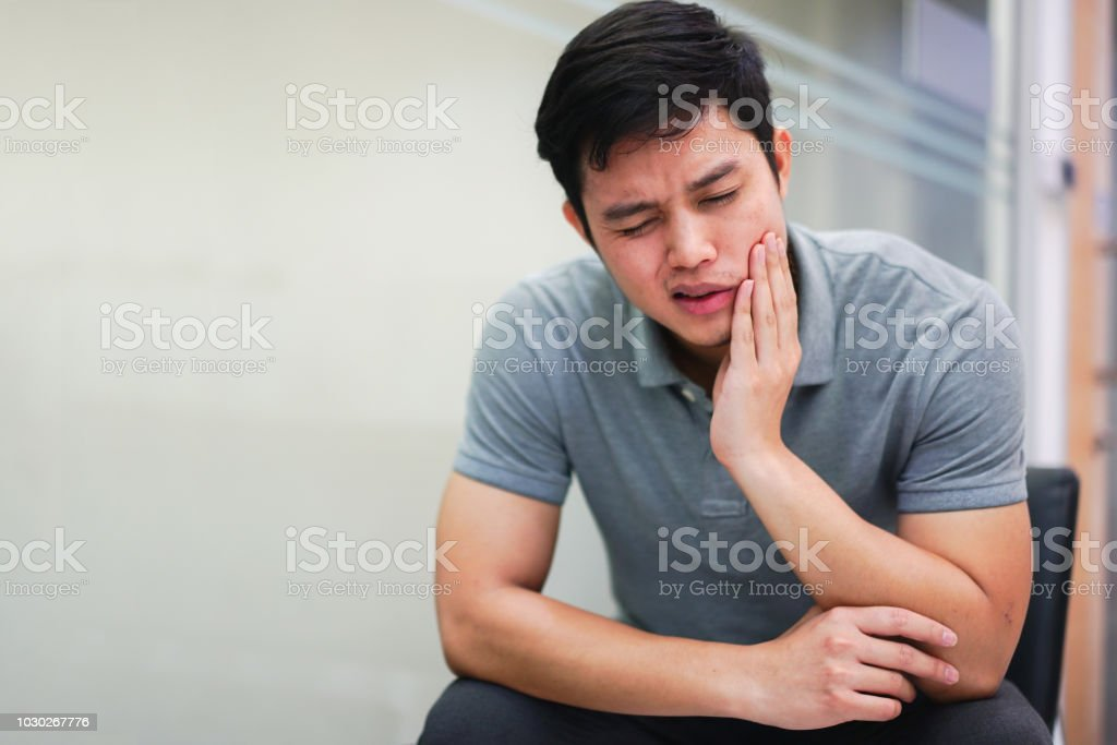 close up asian middle aged man feeling hurt from toothache symptom , unhealthy life concept stock photo