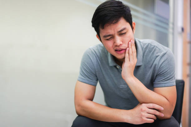 close up asian middle aged man feeling hurt from toothache symptom , unhealthy life concept - wisdom stock pictures, royalty-free photos & images