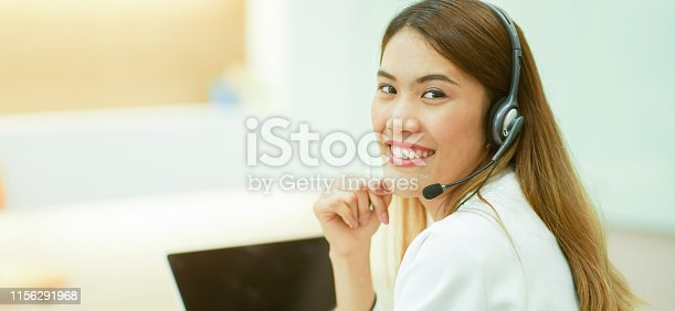 1142008983 istock photo close up asian woman call center agent wear headset device and smiling working in operation room with service-mind at  desktop table , telemarketing and help desk concept 1156291968