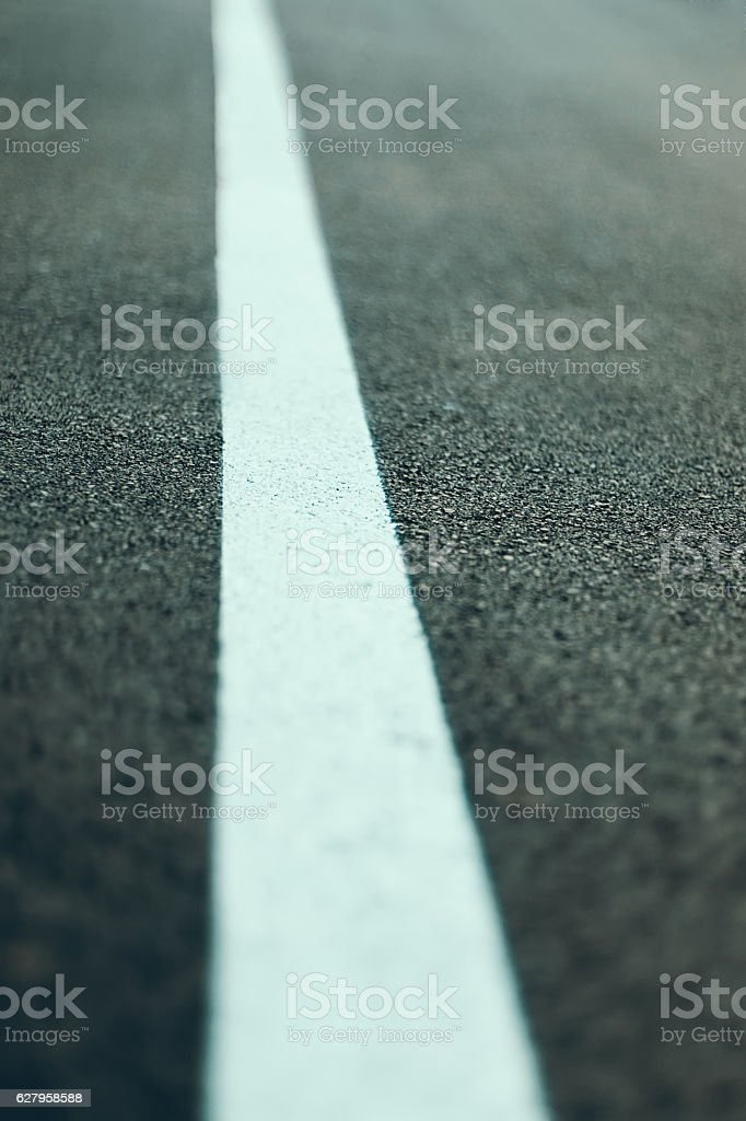 Close up Asphalt road texture with white line stock photo