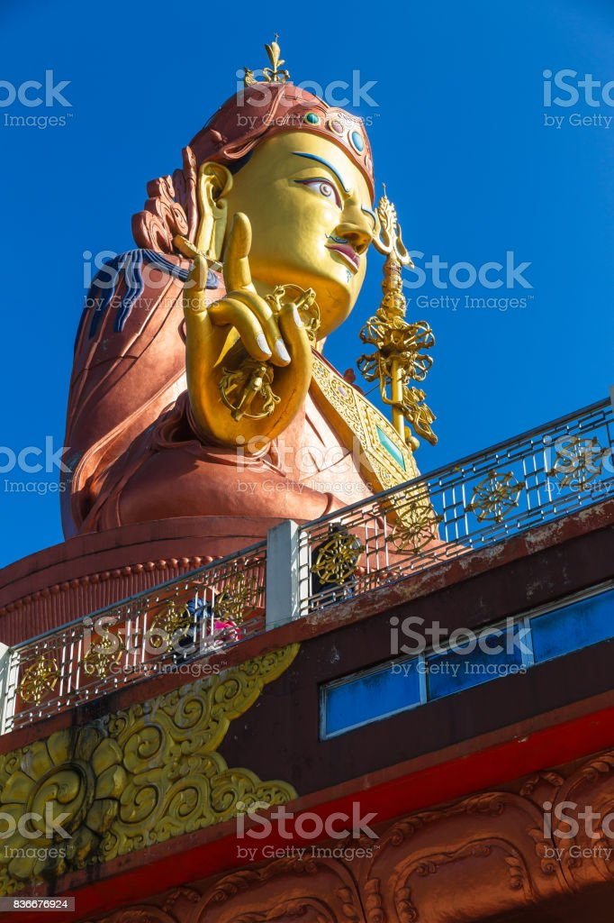 Close up at the side Statue of Guru Rinpoche, the patron saint of Sikkim that view at the base from front and below in Guru Rinpoche Temple at Namchi. Sikkim, India. stock photo