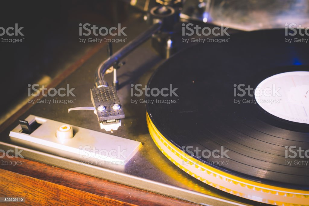 Close up at vintage gramophone. playing old song,Vintage record player with vinyl disc stock photo