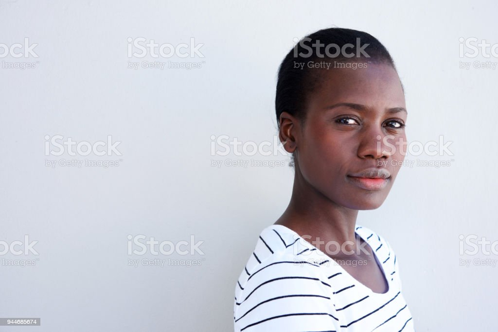 Close up attractive young black woman with serious expression royalty-free stock photo