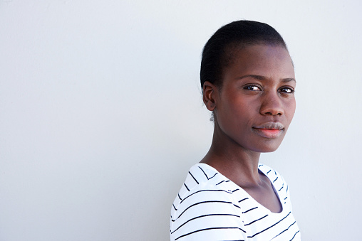 istock Close up attractive young black woman with serious expression 944685674