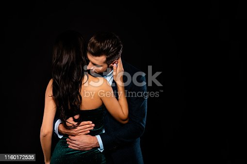 Close up back rear behind photo beautiful she her wife spine he him his husband, mrs mr married spouse hands waist bend touch hold close wear costume jacket green dress isolated black background
