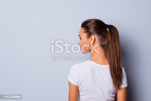 Close up back rear behind side profile view photo amazing beautiful she her lady look side empty space not smiling reliable person wear casual white t-shirt clothes isolated grey background.