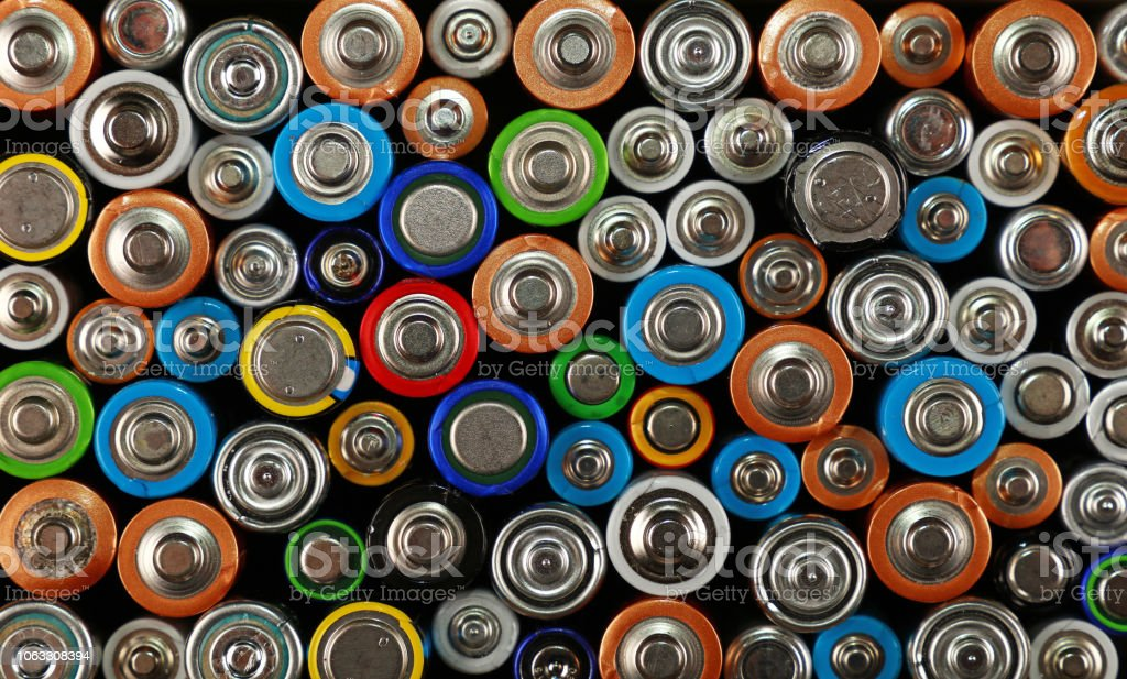 Close up background of various alkaline batteries stock photo