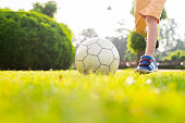 istock Close up ball lying on the grass 1000984130