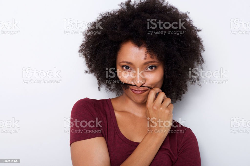 Close Up Beautiful African Woman Holding Hair On Face Like Moustache