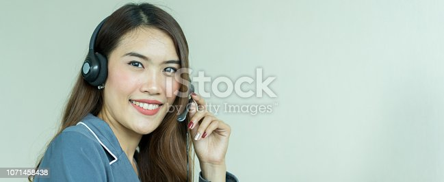 1142008983 istock photo close up beautiful asian woman touching headset for calling to customer or partner in operation room , telemarketing and help desk concept 1071458438