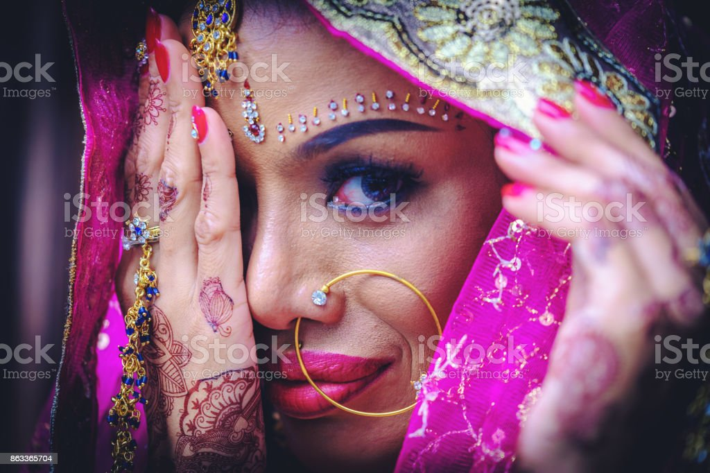 Close up Beautiful indian girl Young hindu woman model with kundan jewelry. stock photo