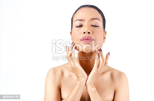 istock Close up beautiful middle age Asian woman's face hands touching her chin isolated on white background , beauty concept 859556180