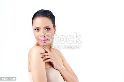 istock Close up beautiful middle age Asian woman's face hands touching her shoulder isolated on white background , beauty concept 862717366