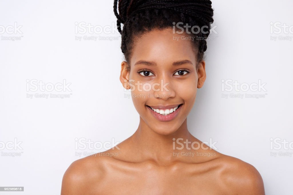 12a6722f267 Close up beautiful young black woman against white background - Stock image  .