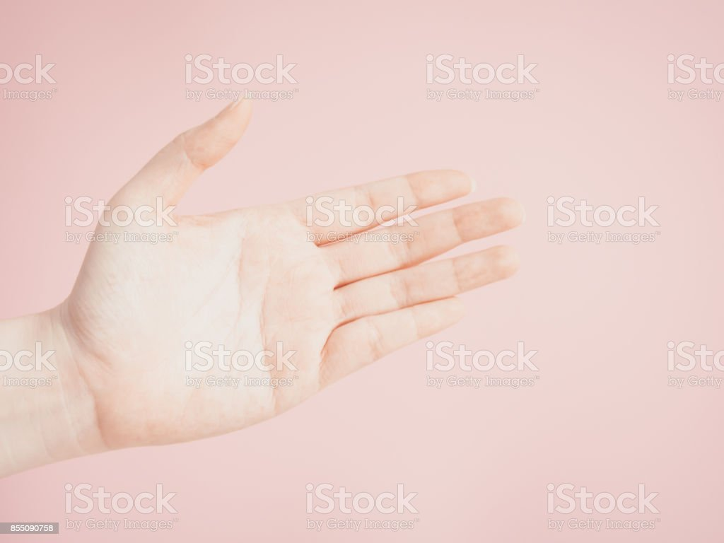 close up beauty woman left hand show signal by open the palm of the hand with pink pastel background stock photo