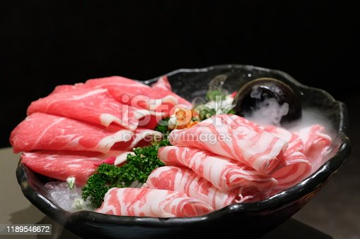 Raw food for hot pot. Blurred dark background