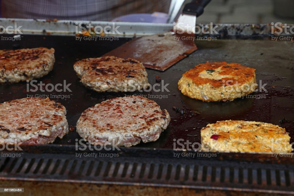Close up beef burgers for hamburger on bbq grill stock photo
