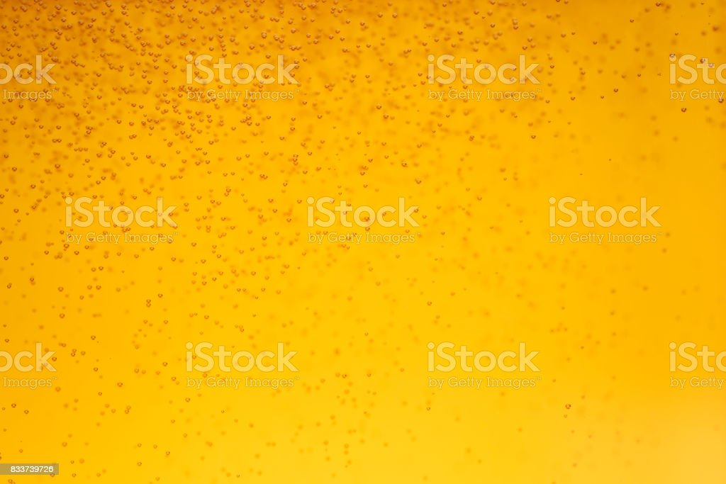 close up beer with bubbles background stock photo
