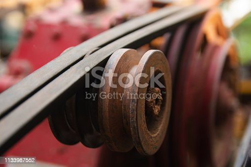 841283930 istock photo Close up belt and pulley on the motor 1133987552