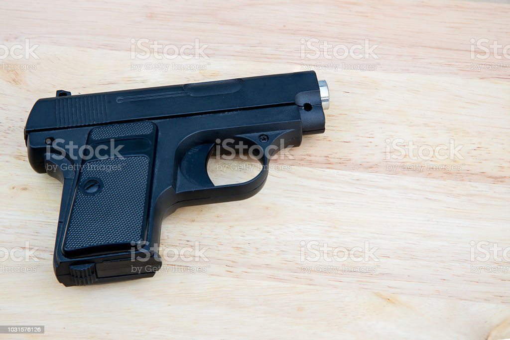 Close Up Black Airsoft Gun Isolated On Wooden Background Firearm