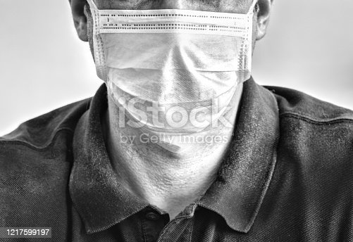 Close up black and white portrait of caucasian man adult wearing anti virus bacteria pollution protective mask. coronavirus covid-19 background