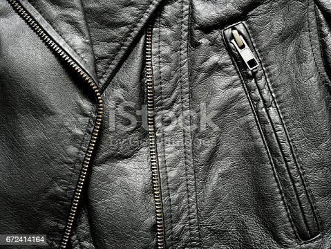 istock Close up black leather jacket 672414164